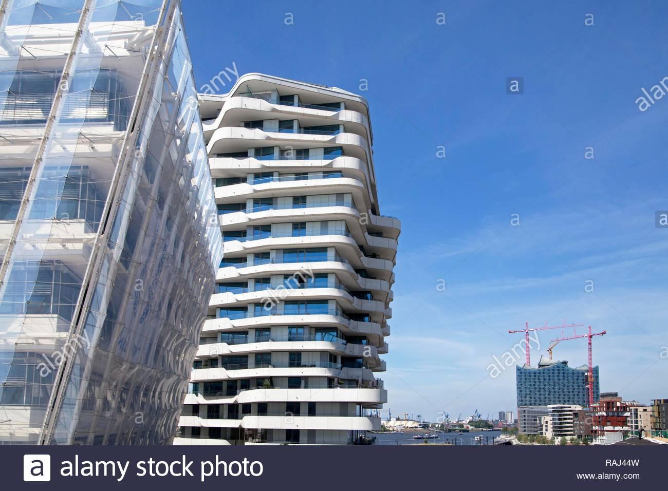 Unilever House, Marco Polo Tower and Elbe Philharmonic Hall at back, HafenCity quarter, Hamburg, PublicGround - Stock Image