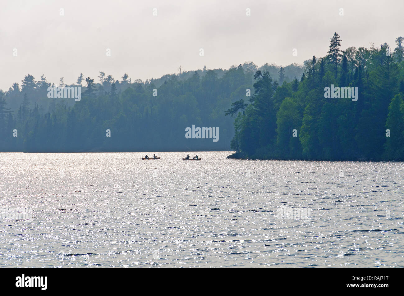 Fishermen silhouetted on Winchell Lake in the Boundary Waters - Stock Image