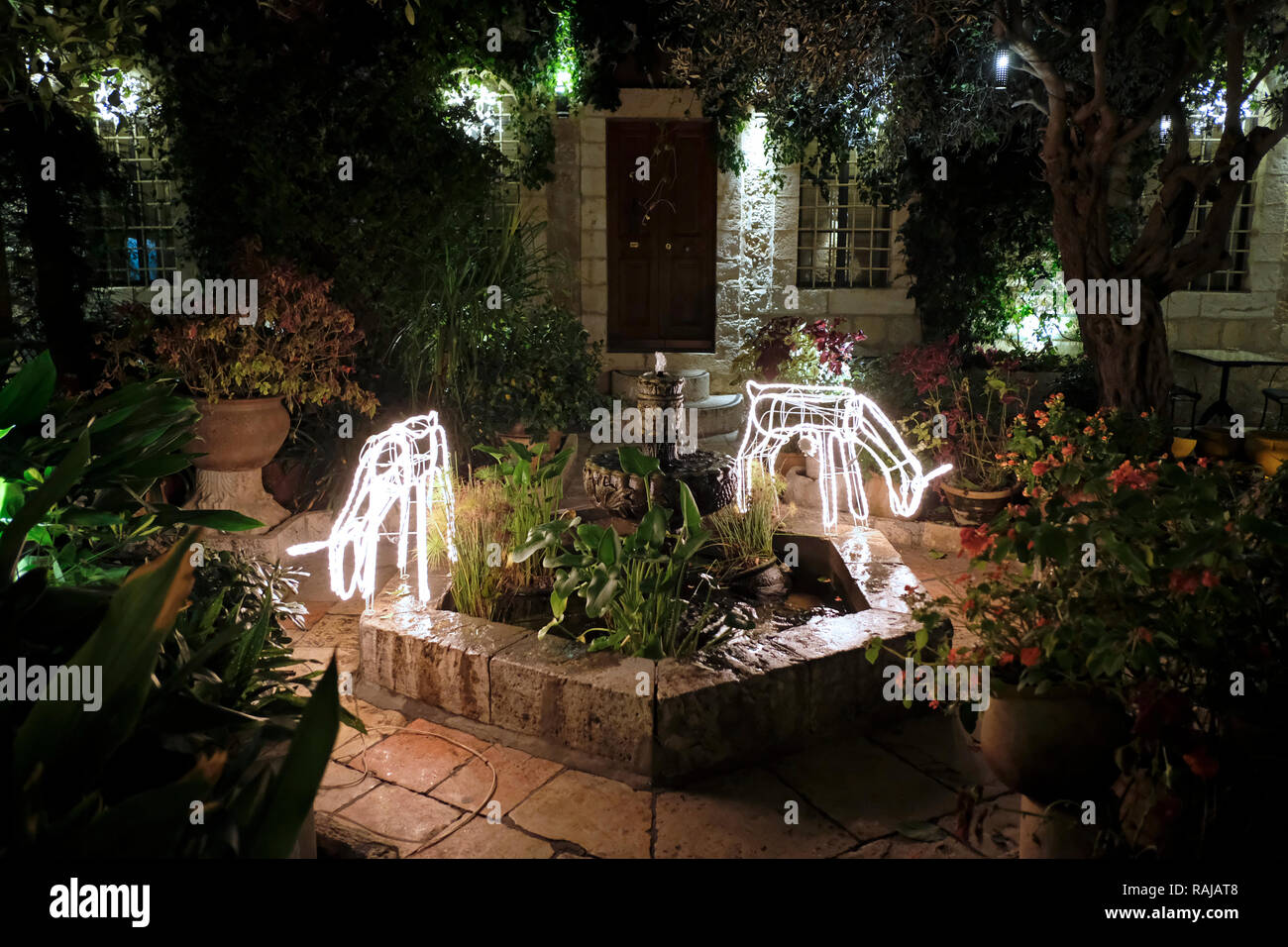 Christmas decorations at the inner courtyard of the American Colony Hotel located in a historic building which previously housed the utopian American-Swedish community known as the American Colony in East Jerusalem Israel - Stock Image