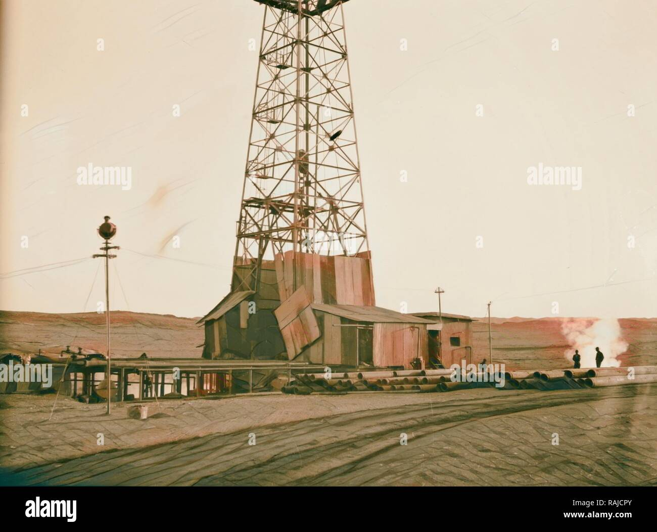 Iraq, oil fields, drilling tower  Photo possibly shows oil