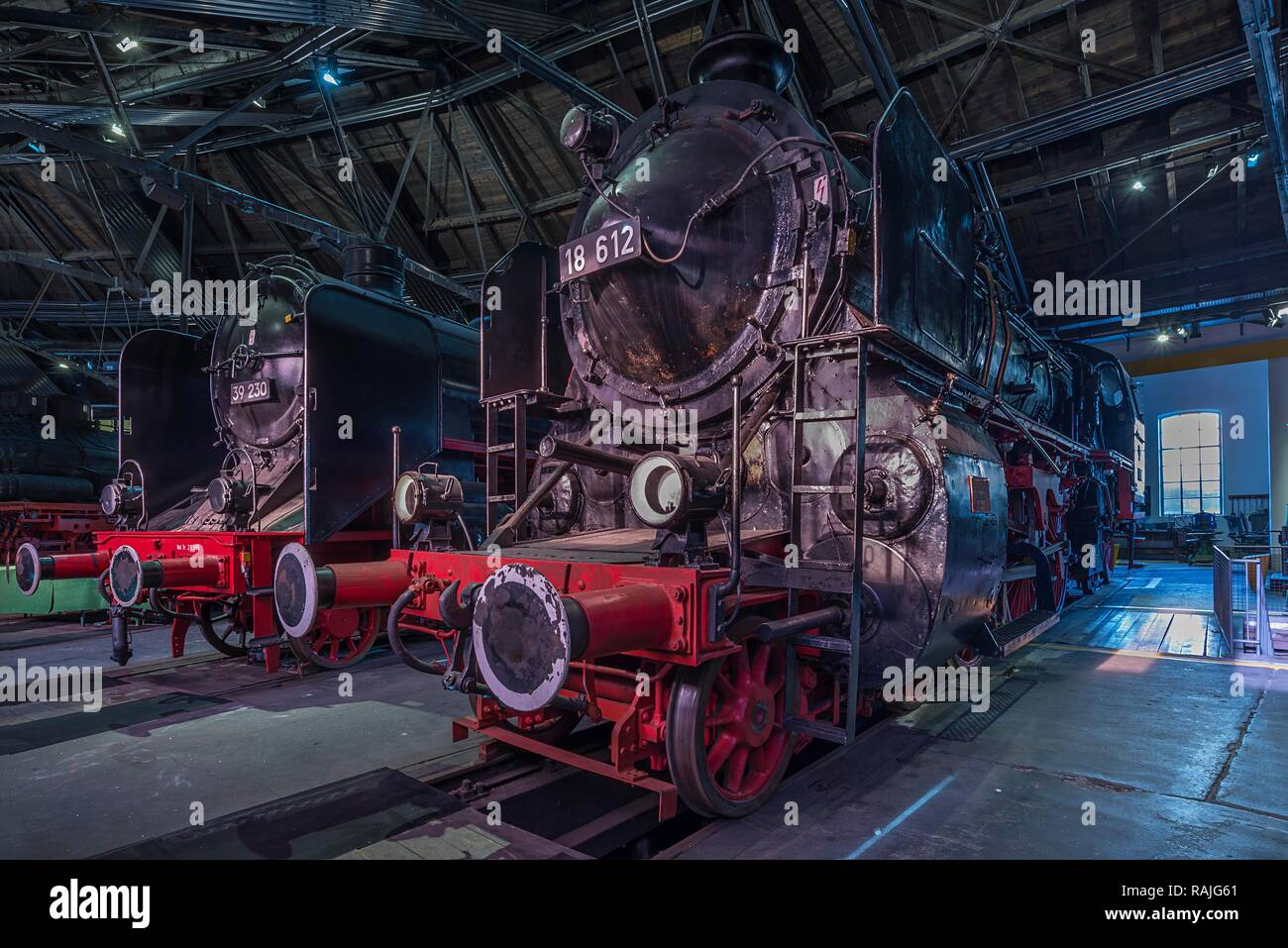 Steam Locomotives 39 230 and 18 612 in the Ringlokschuppen, German Steam Locomotive Museum, Neuenmarkt, Upper Franconia, Bavaria - Stock Image