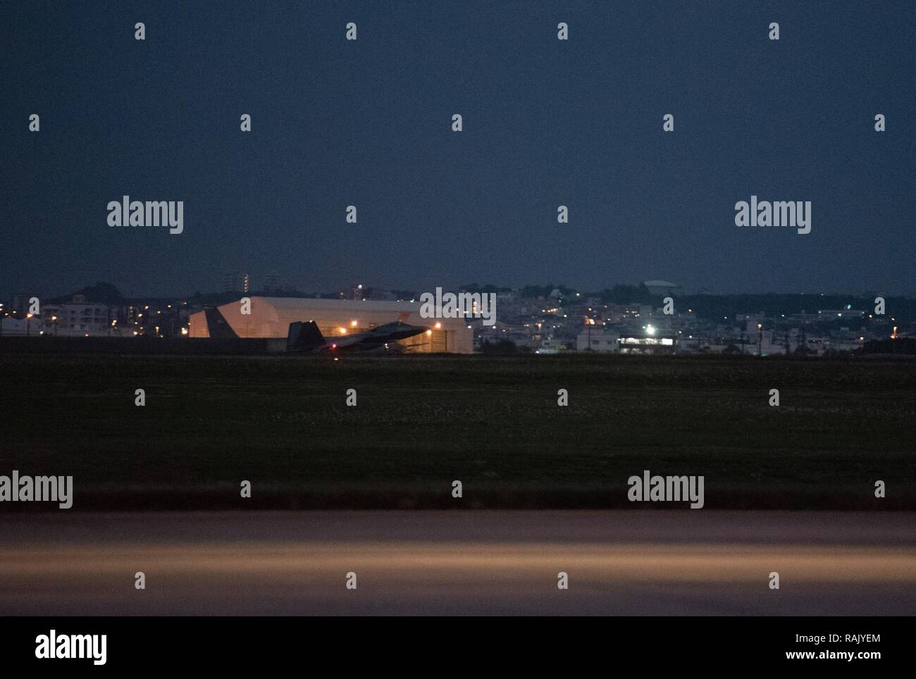 U.S. Air Force F-22 Raptors from the 90th Fighter Squadron arrive at Kadena Air Base, Japan, Feb. 7, 2017, before traveling on to Royal Australian Air Force Base, Tindal. The U.S. Air Force and the RAAF train together as part of the U.S. and Australian Enhanced Air Cooperation Agreement. Enhanced air cooperation increases both the U.S. and Australia's combined capabilities, improving security and stability throughout the Indo-Asia-Pacific region. - Stock Image