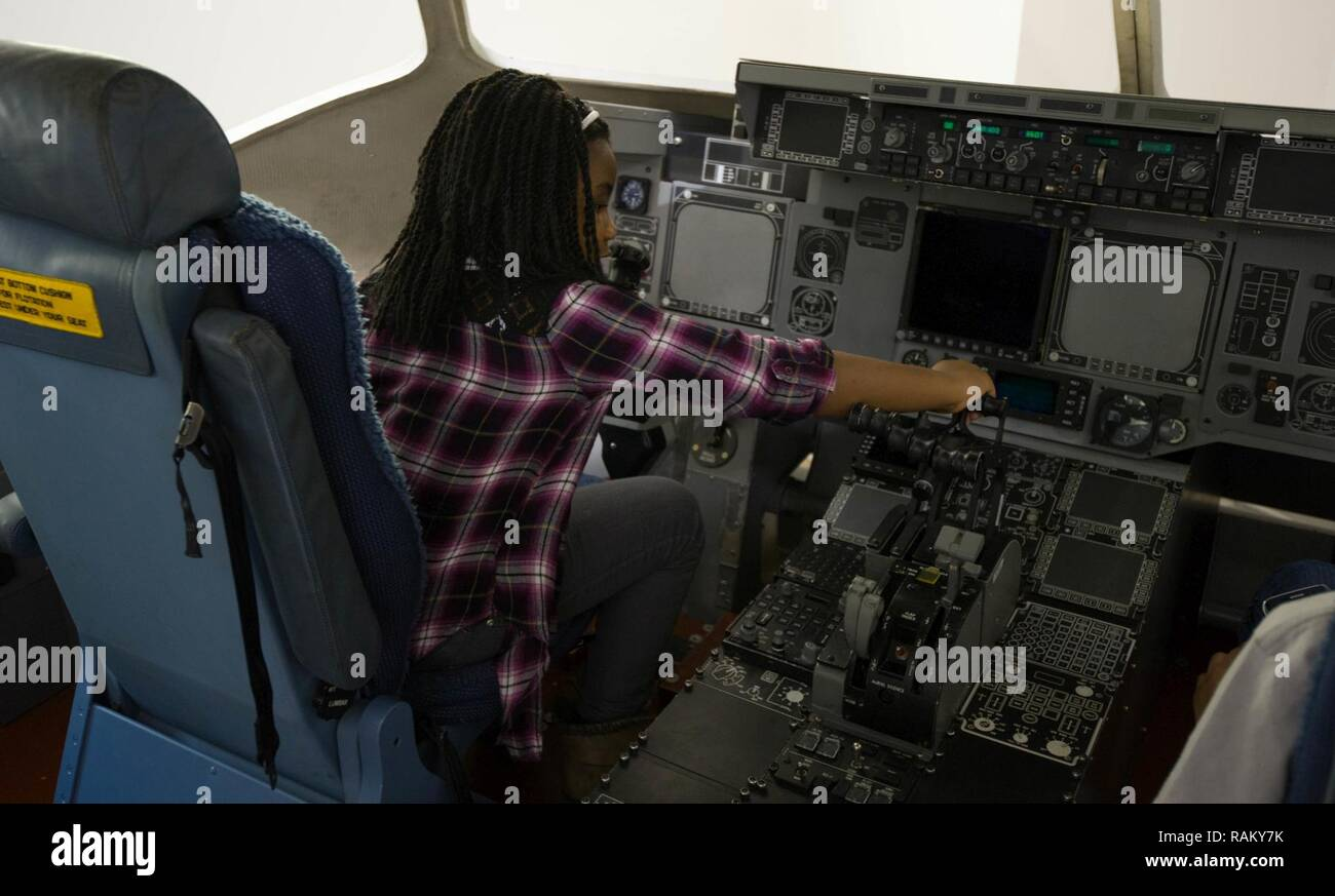 Kyla Palmer, 9, engages the controls of a mock up of a C-17