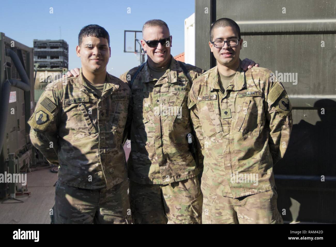 Brig. Gen. Robert D. Harter, deputy commanding general of the 1st Sustainment Command (Theater) / commanding general of the 316th Sustainment Command (Expeditionary), (center), poses with Spc. Brian Ramirez, (left), and Spc. Jose Perez, (right), both mortuary affairs specialists with the 246th Quartermaster Company (Mortuary Affairs), an U.S. Army Reserve unit based out of Mayaguez, Puerto Rico, in Erbil, Iraq on February 3, 2017. - Stock Image