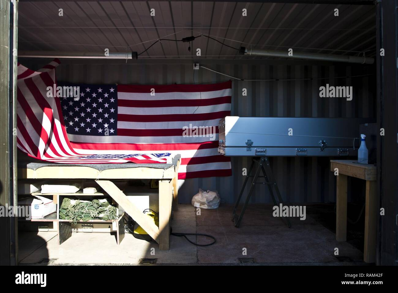 This is a container that includes a steamer and iron for removing wrinkles in flags, a rope system that can drape flags over top a transfer cases (casket) and a transfer case owned and operated by the 246th Quartermaster Company (Mortuary Affairs), in Erbil, Iraq on February 3, 2017. - Stock Image