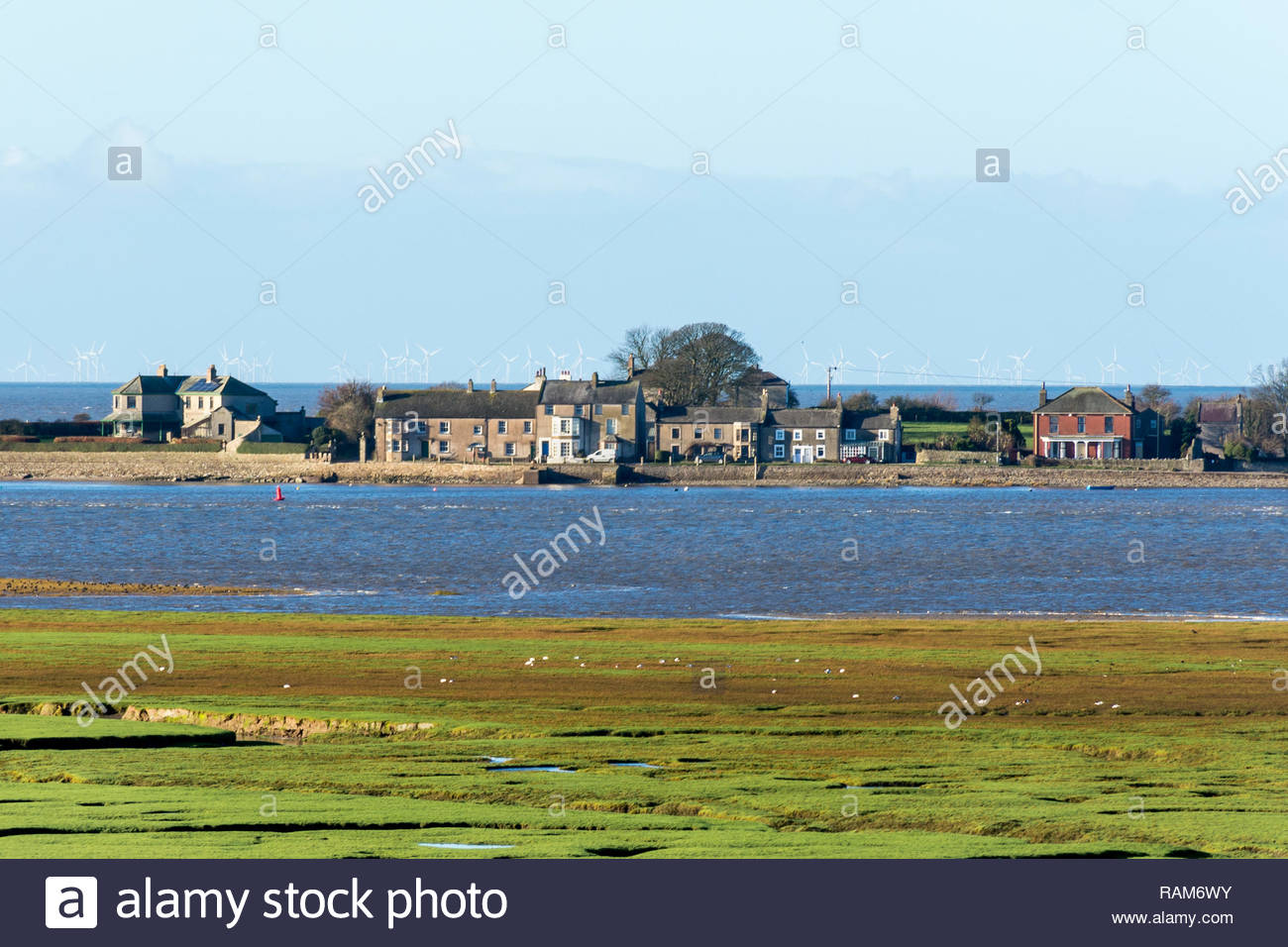 The isolated houses on Sunderland Point, Lancashire,  which is cut off at high tide. Photo taken from across the River Lune at Glasson Dock Stock Photo