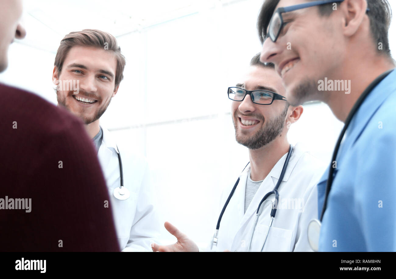 group of doctors advising the patient - Stock Image