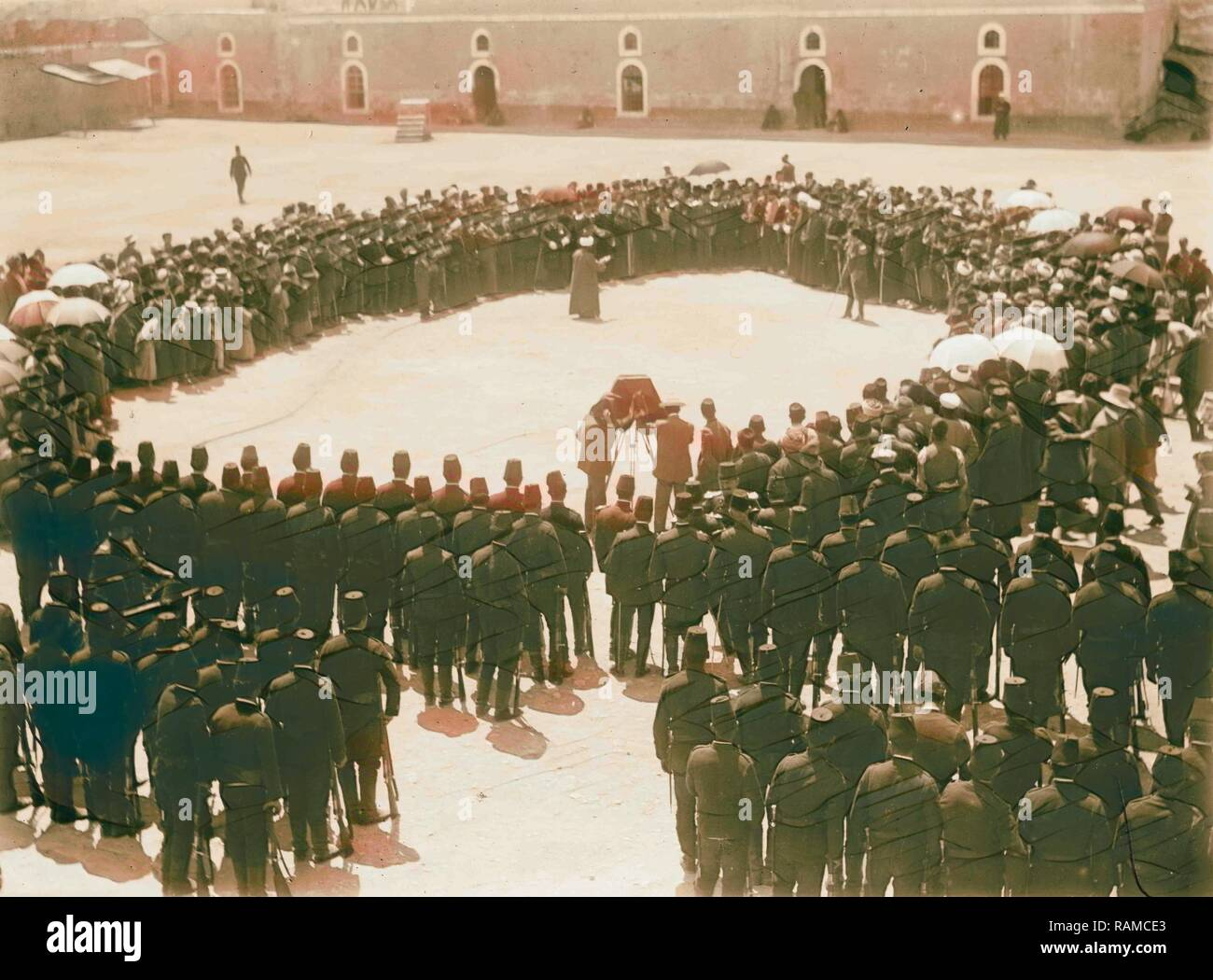Turkish military WWI. Man being photographed in a circle of people with Turkish army. 1914. Reimagined - Stock Image