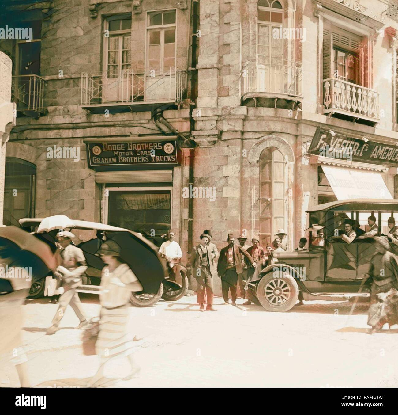 Corner of Grand Hotel showing American Colony stores and Dodge auto business (one of Am. Colony enterprises). 1920 reimagined - Stock Image