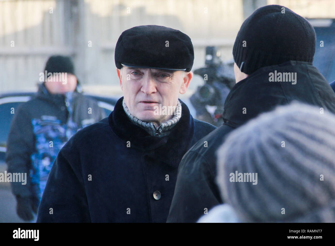 Magnitogorsk, Russia. 04th Jan, 2019. MAGNITOGORSK, RUSSIA - JANUARY 4, 2019: The Governor of Chelyabinsk Region, Boris Dubrovsky (C front), at the funeral of a young family who died in a gas explosion; a section of a ten-storeyed apartment block collapsed at 164 Karla Marksa Street in Magnitogorsk, Russia, early on 31 December 2018 following a gas explosion; 39 people have been killed in the accident. Ilya Moskovets/TASS Credit: ITAR-TASS News Agency/Alamy Live News - Stock Image