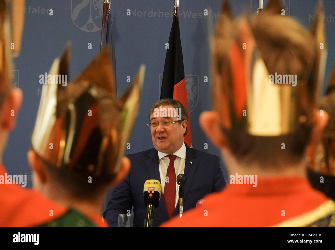 04 January 2019, North Rhine-Westphalia, Düsseldorf: North Rhine-Westphalia's Prime Minister Armin Laschet (CDU) welcomes Sternsinger to the State Chancellery in Düsseldorf. Laschet praised the use of the star singers as 'lived charity'. Photo: David Schwarz/dpa - Stock Image