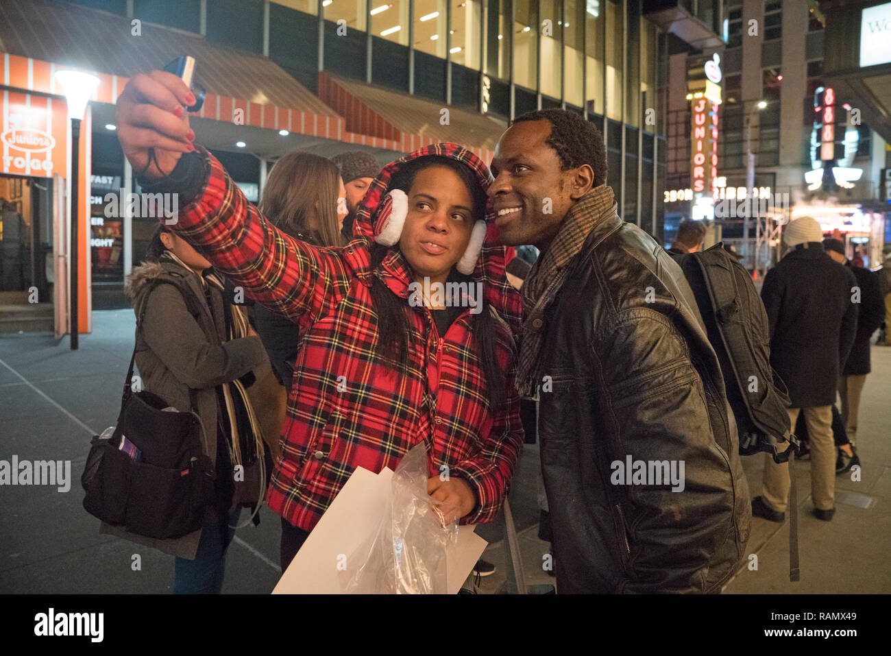 "New York, NY, 3 January 2019 - Gbenga Akinnagbe, who plays Tom Robinson in the Broadway production of ""To Kill a Mockingbird,"" with a fan after the show. Aaron Sorkin's adaption of Harper Lee's novel shattered records in its second full week of performances, grossing $1.702 million. That makes it the highest single-week grossing American play in Broadway history. Photo: Credit: Terese Loeb Kreuzer/Alamy Live News - Stock Image"