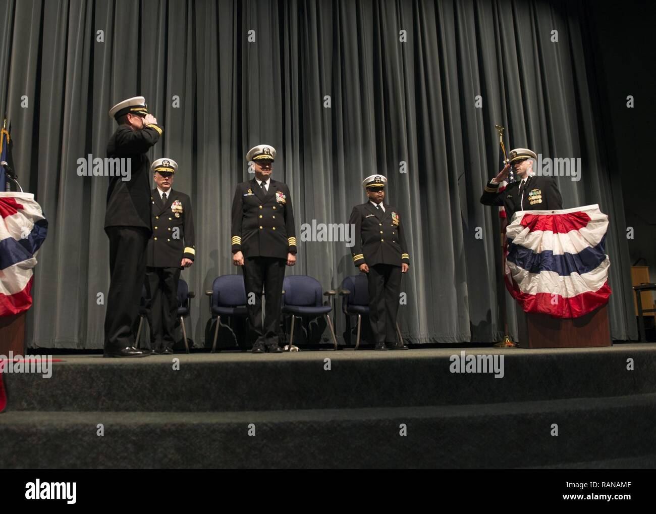 KEYPORT, Wash. (Feb. 27, 2017) Cmdr. Donald Tenney, left, commanding officer of the Los Angeles-class fast-attack submarine USS Albuquerque (SSN 706) orders the executive officer, Lt. Cmdr. Ryan Kramer, to secure the watch during the boat's decommissioning ceremony held at Keyport Undersea Museum. Albuquerque concluded 33 years of service as the second U.S. Navy warship to be named after Albuquerque, New Mexico. - Stock Image