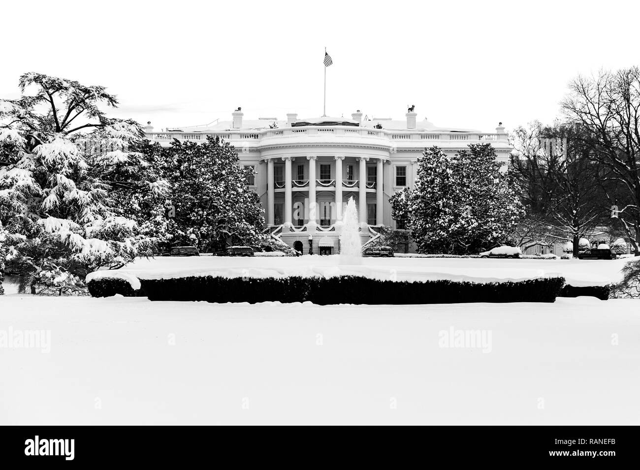 The White House in Washington DC after a record snow fall in the winter of 2009. - Stock Image
