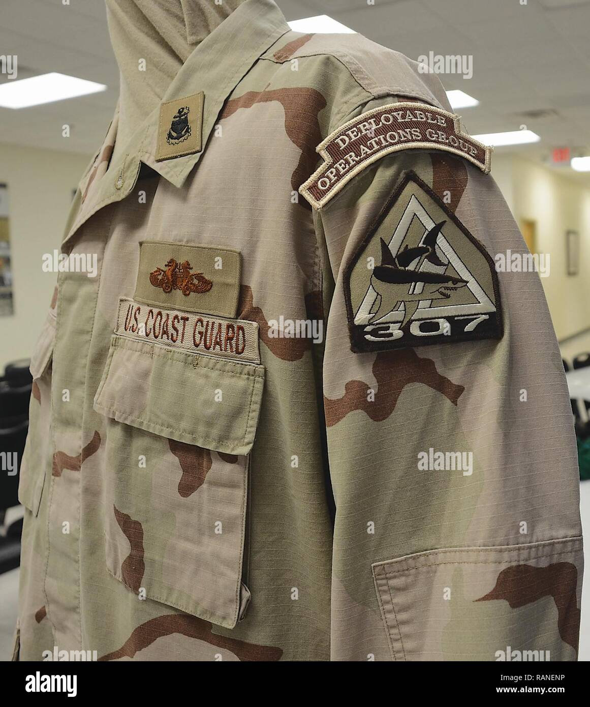 This Coast Guard Desert Combat Uniform represents a Chief Petty Officer assigned to the 307th Port Security in Clearwater, Fla. The uniform is among the hardest to find since only a few few thousand Coast Guardsmen deployed.   This unit saw deployments to Iraq and Guantanamo Bay, Cuba. Stock Photo