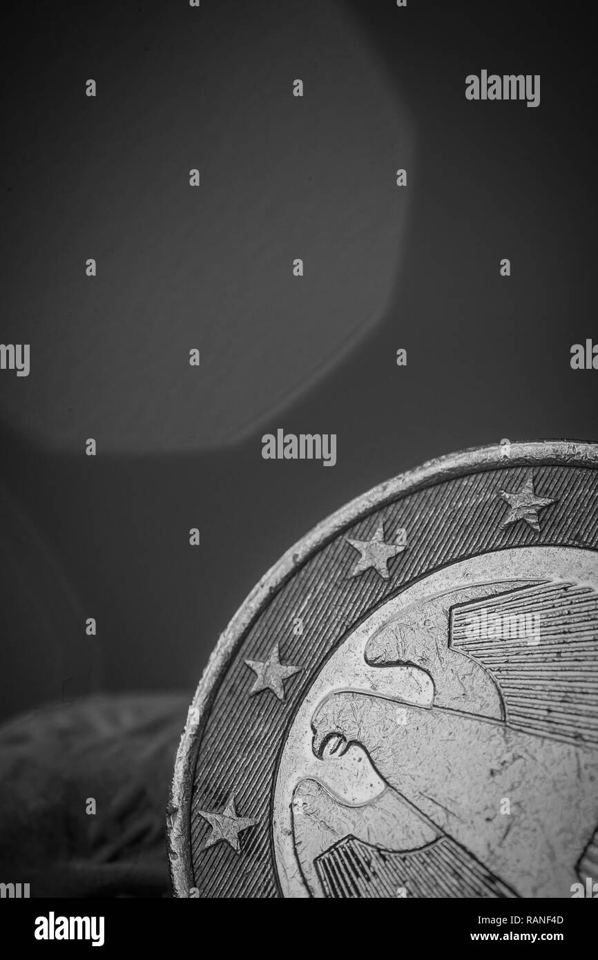 Closeup on part of a one Euro coin showing some stars and part of the eagle - Stock Image