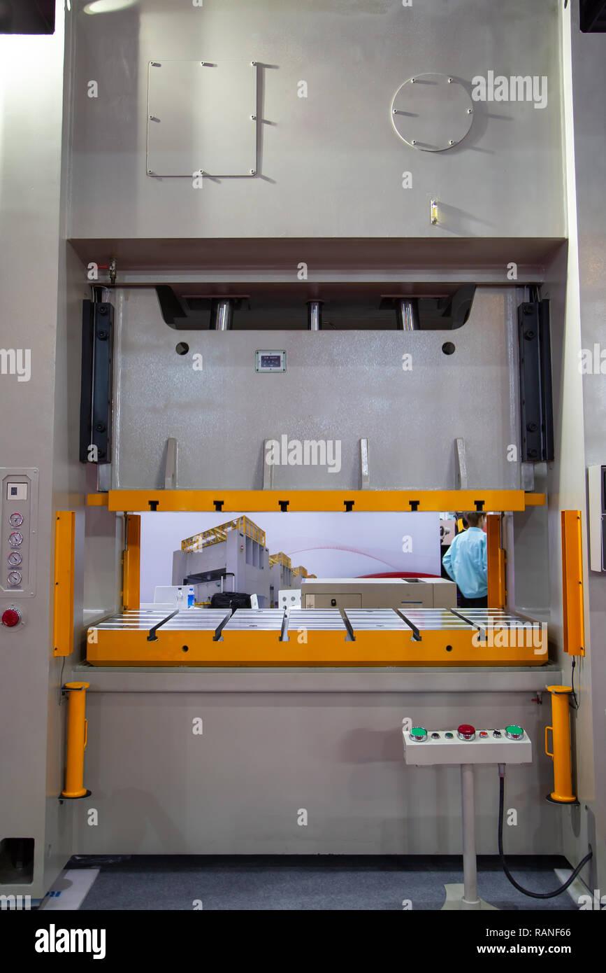Large metal stamping press machine, industrial manufacturing - Stock Image
