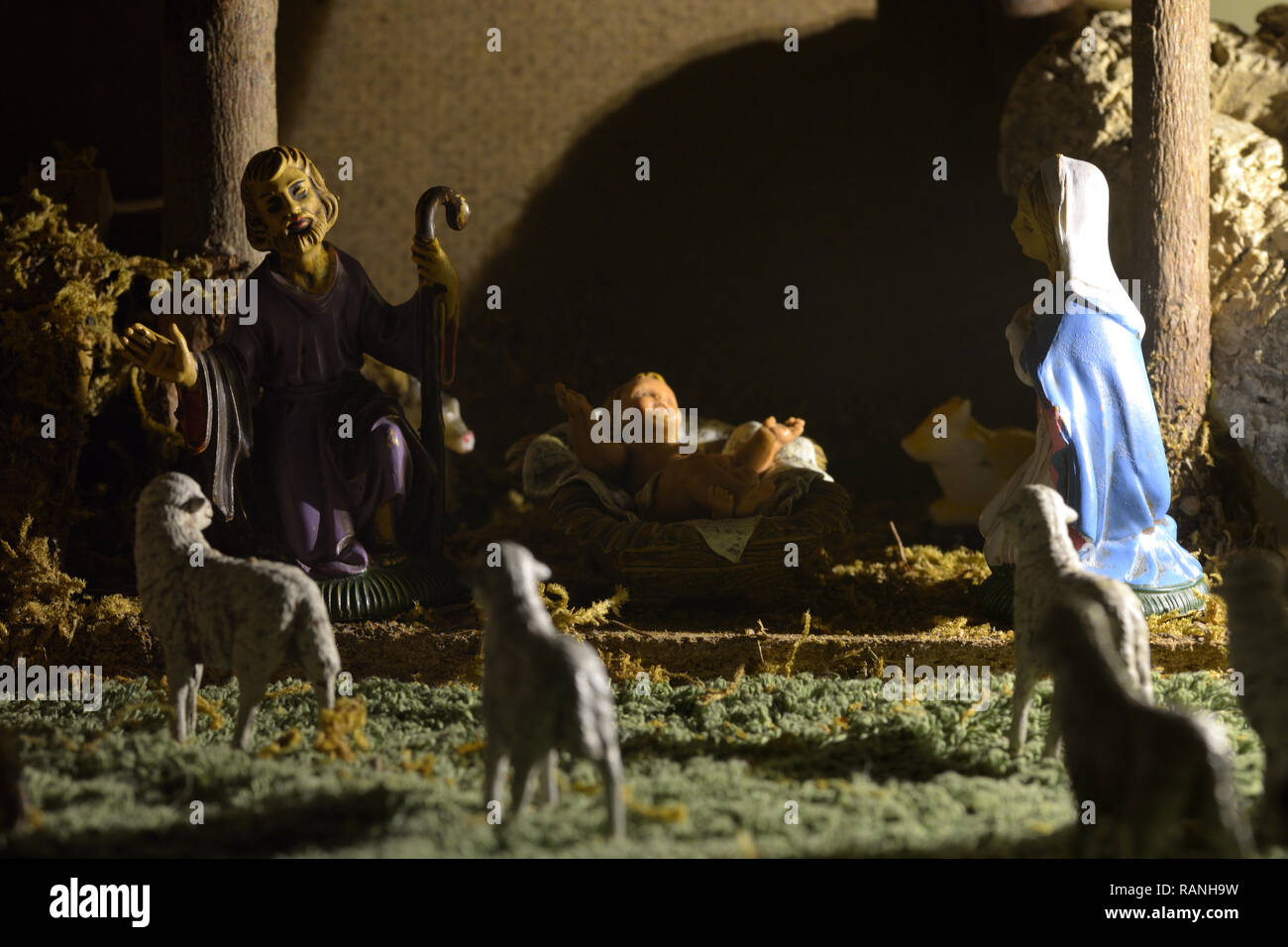 Traditional nativity scene with statues of the Holy Family. Nativity Scene with statues of Joseph, Mary and the little Jesus inside the hut. Stock Photo