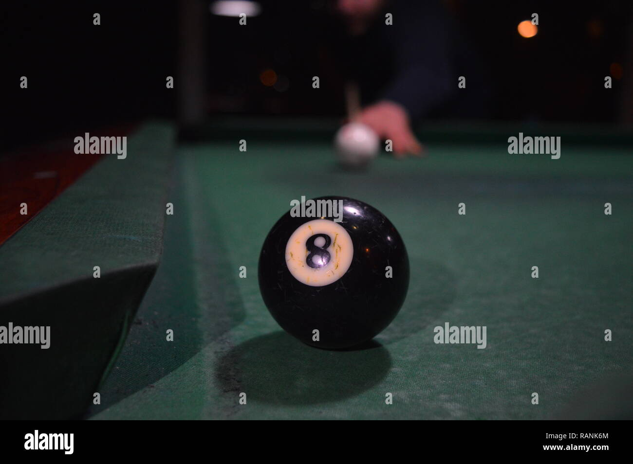 Game of pool, person playing pool and hitting balls - Stock Image
