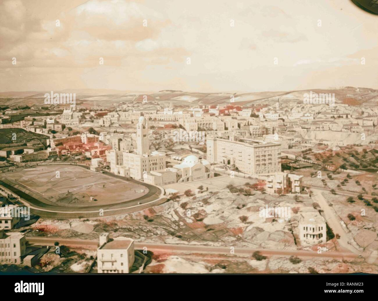 Air views of Palestine. Newer Jerusalem. Y.M.C.A. and King David Hotel from S.W. 1931, Jerusalem. Reimagined - Stock Image