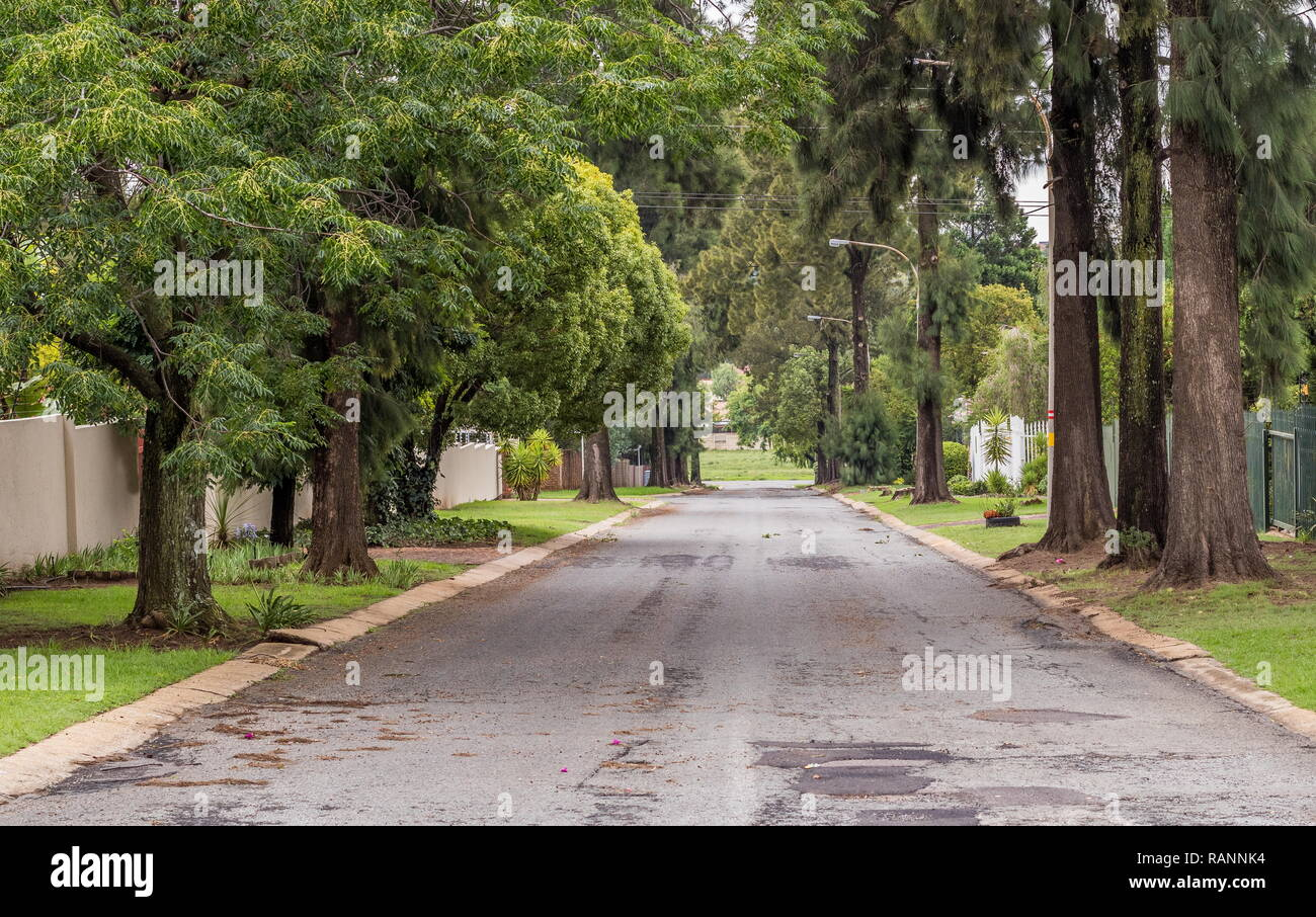 A long straight road going downhill image with copy space in landscape format - Stock Image