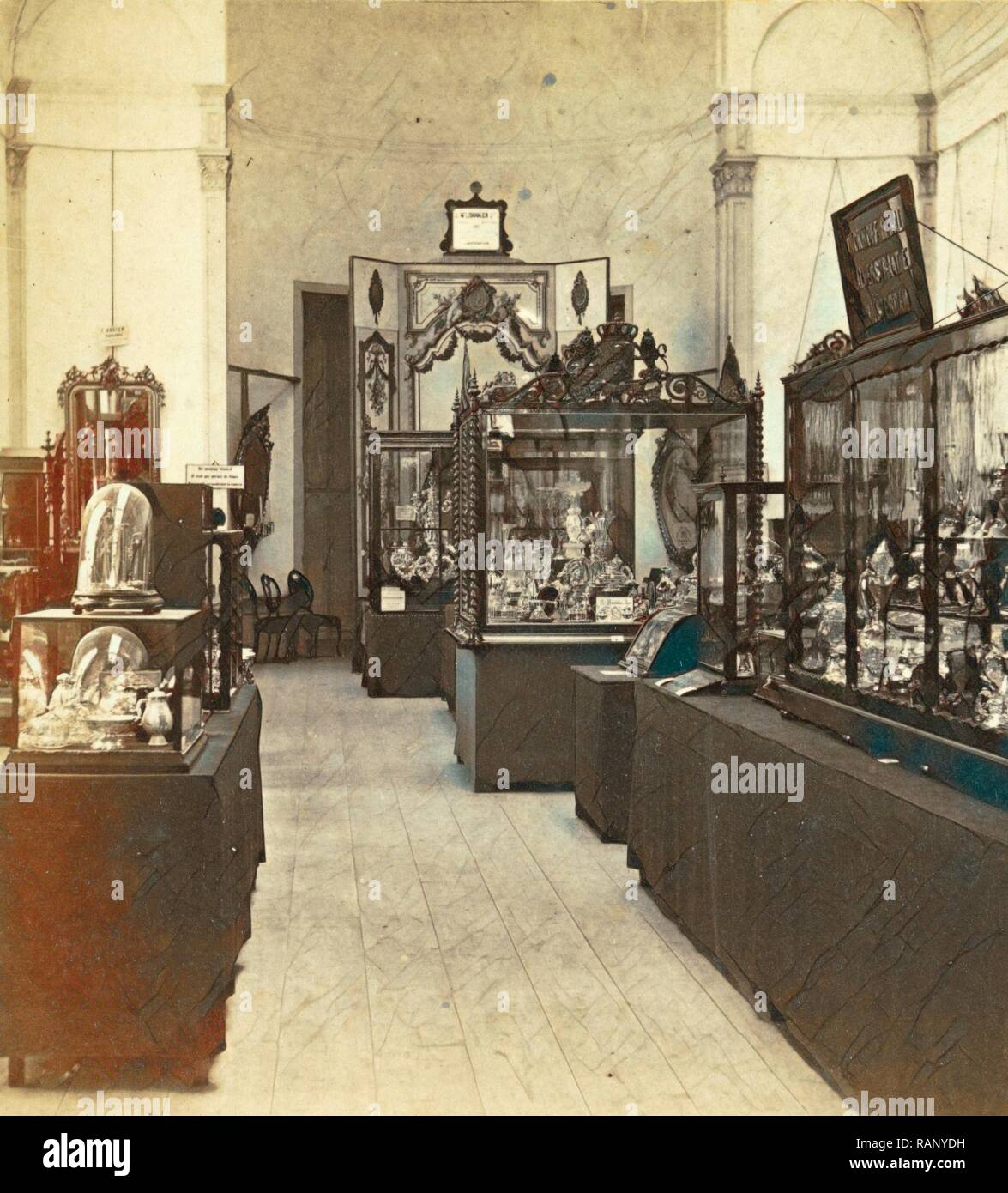Display cabinets with objects in the exhibition of National Industry and Art in the Palace of Industry, Amsterdam reimagined Stock Photo