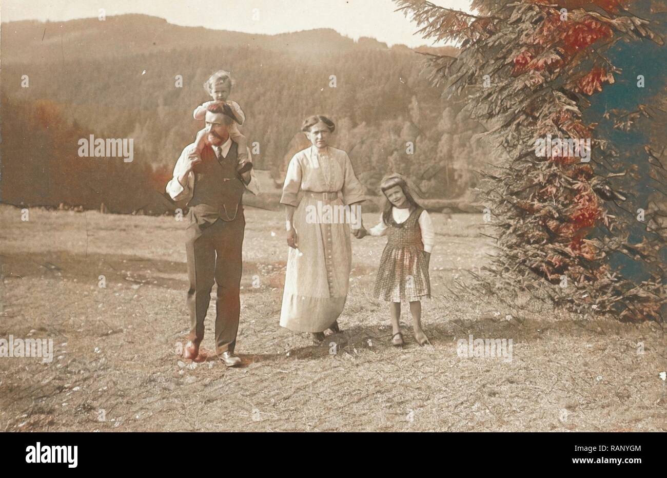 Waldemar Titzenthaler, the photographer, with his wife Olga and children Marba and Eckart in a clearing, Waldemar reimagined - Stock Image