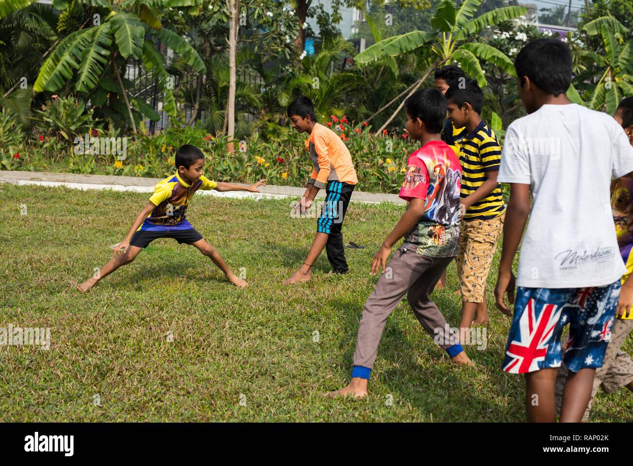 Mumbai / India - December 2017: Children playing Kabaddi, a contact team sport. - Stock Image