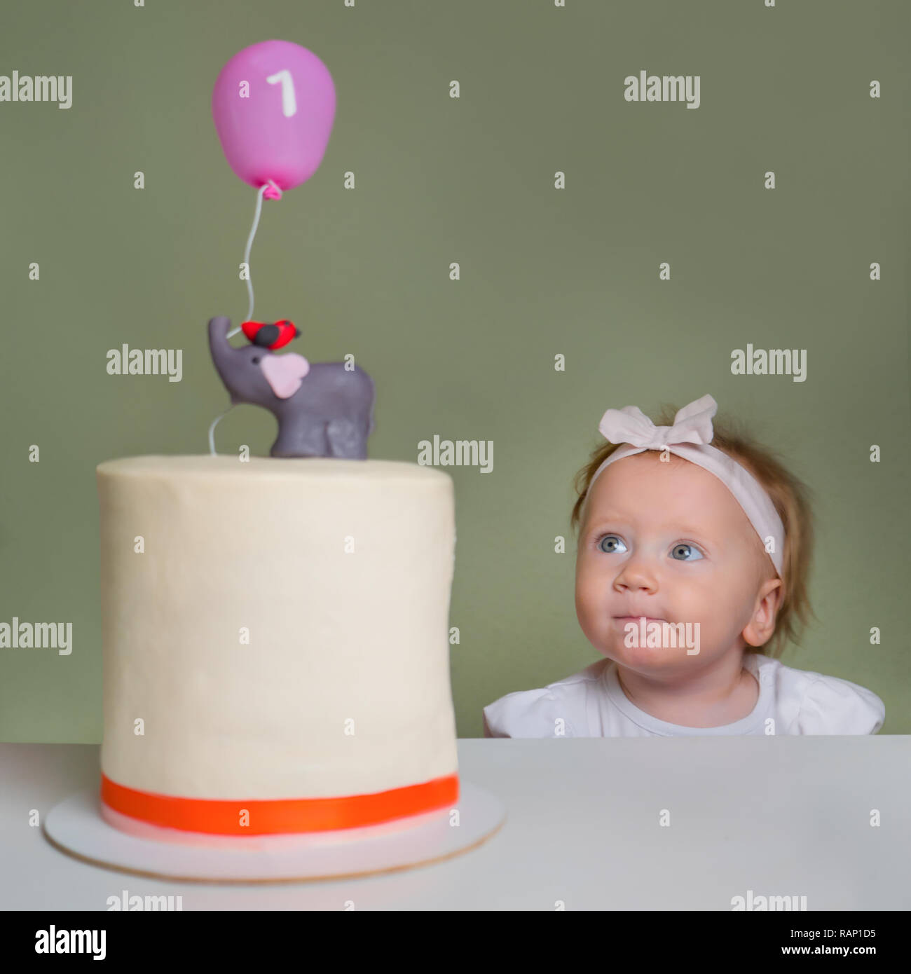 Baby Girl Looking On Birthday Stollen Cake Positive Emotions The Face Of Little