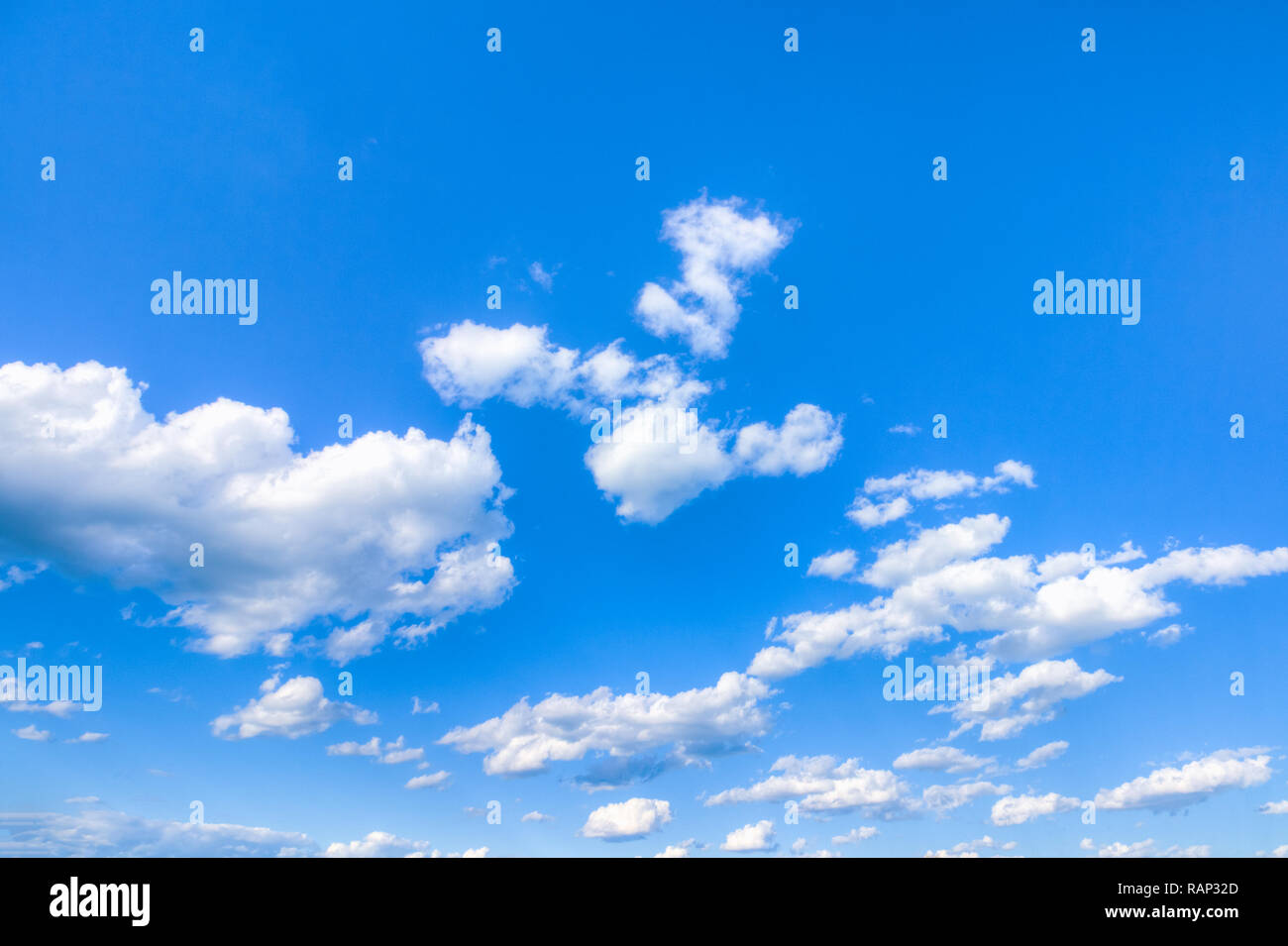 Background blue sky with cumulus white clouds - Stock Image