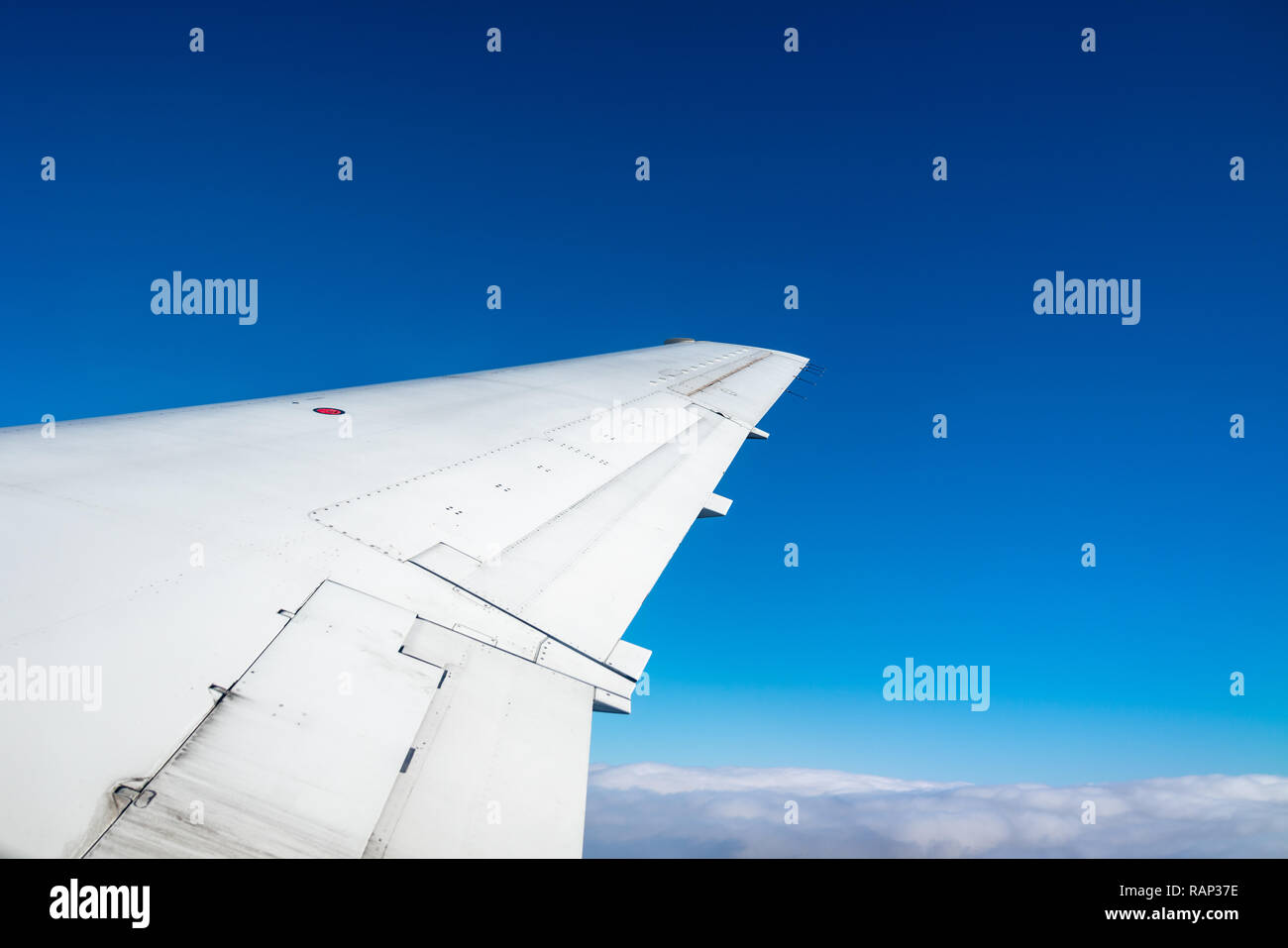 New York, USA,  29DEC2018 - The wing of an Embraer ERJ-135 twin-jet is seen against the sky as it departs from New York La Guardia airport.  Photo by  - Stock Image