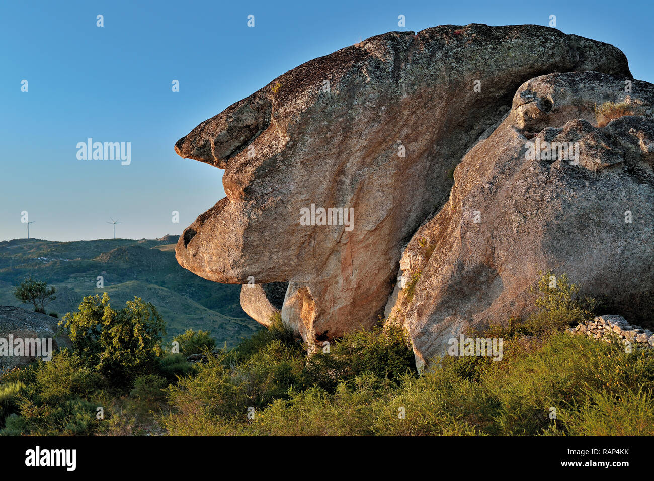 Enormous nature sculptured granite rock showing the silhouette of an old woman - Stock Image