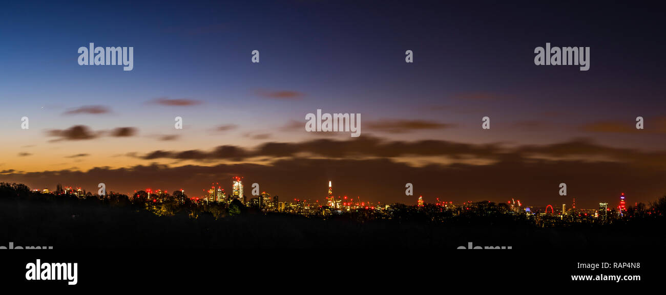 Panorama of the London skyline at dawn from Hampstead Heath, London, UK - Stock Image
