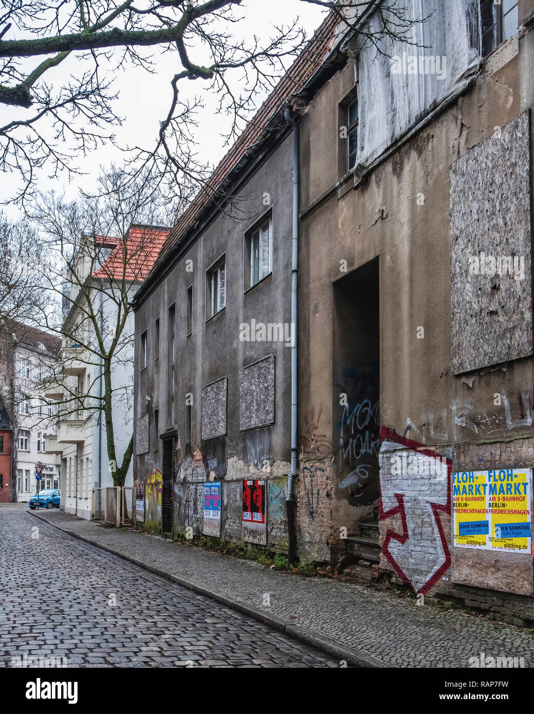 Berlin, Alt-Kopenick. Old decrepit buildings awaiting renovation. Boarded up, graffiti covered and decaying - Stock Image