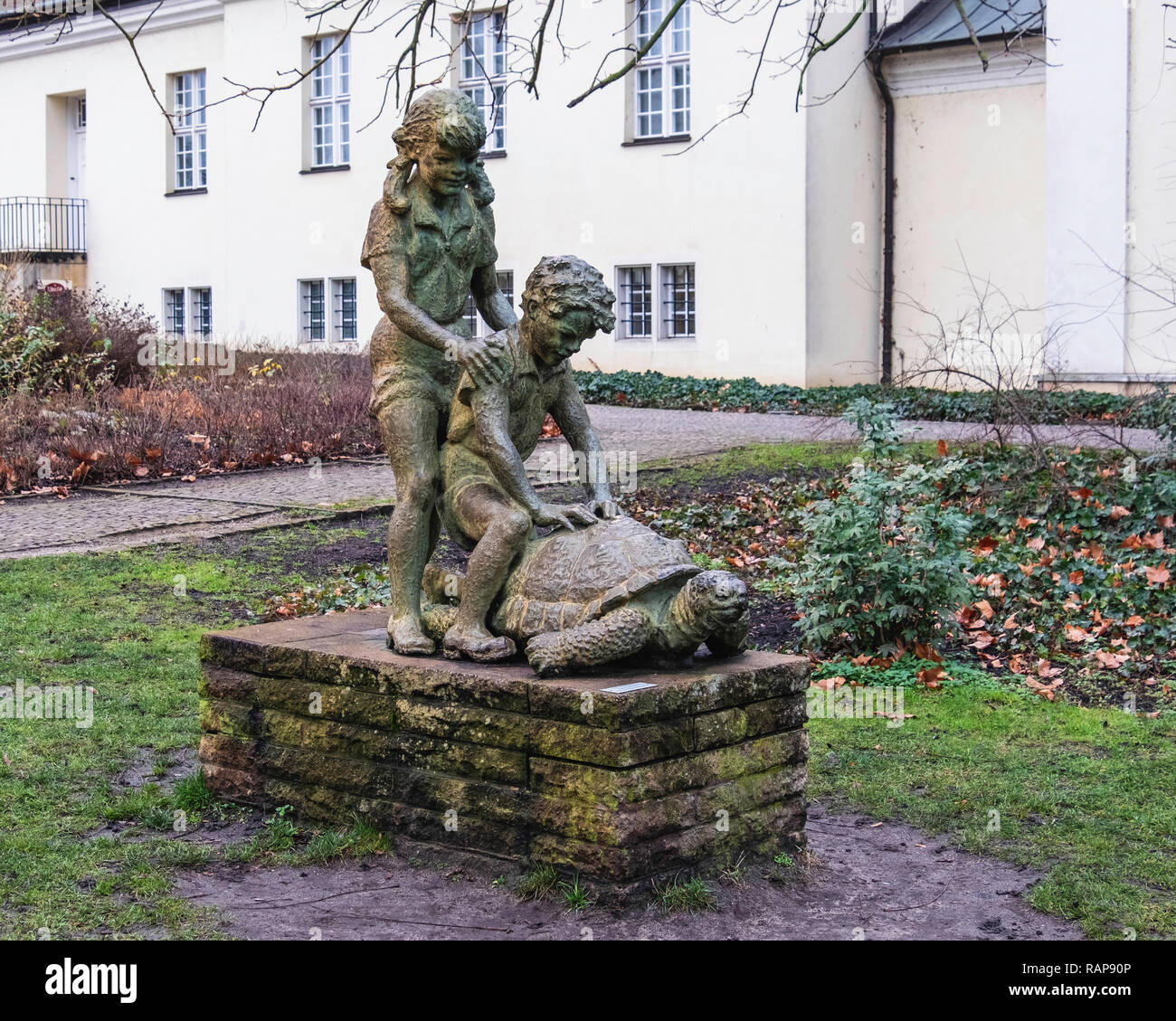 Berlin-Köpenick Sculpture of Children with Tortoise by sculptor Waler Lerche in Schloss Palace park located on an island in the Dahme river. - Stock Image