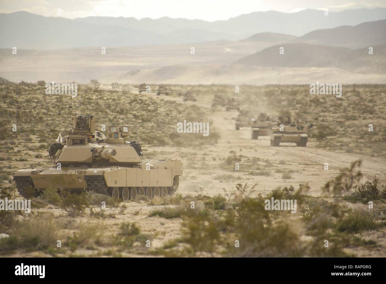 [Tomorrow's Earth] Chapitre I: Arrival - Page 2 Us-soldiers-assigned-to-the-2nd-brigade-1st-cavalry-division-move-a-caravan-of-abrams-tanks-through-a-stretch-of-desert-during-decisive-action-rotation-17-04-at-the-national-training-center-in-fort-irwin-calif-feb-26-2017-RAPGRG