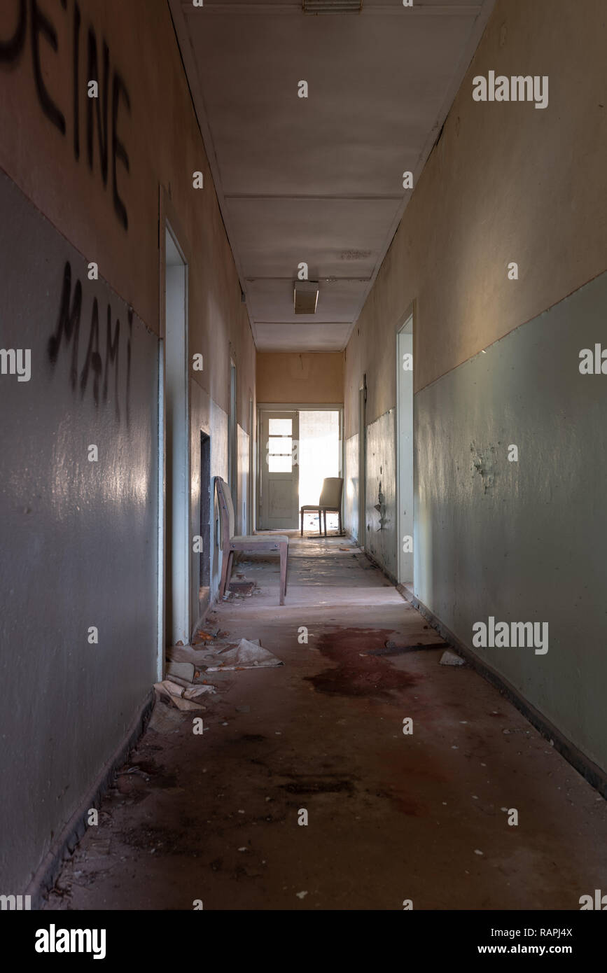 Prerow, Germany - December 30, 2018: View into the corridor of a barrack of the former training camp of the Gesellschaft für Sport und Technik in Prer - Stock Image