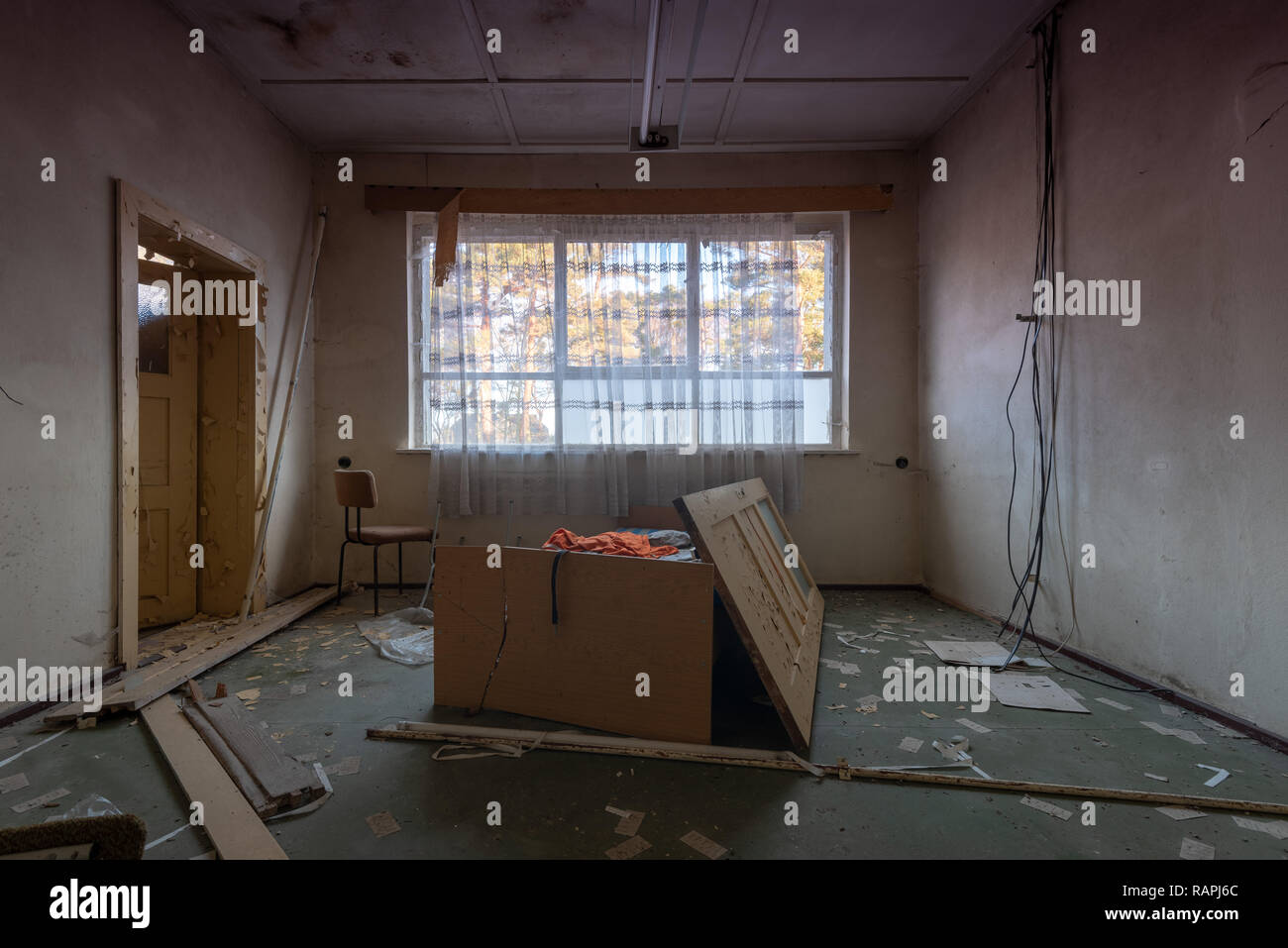 Prerow, Germany - December 30, 2018: View into an empty room of a barrack of the former training camp of the Gesellschaft für Sport und Technik in Pre - Stock Image