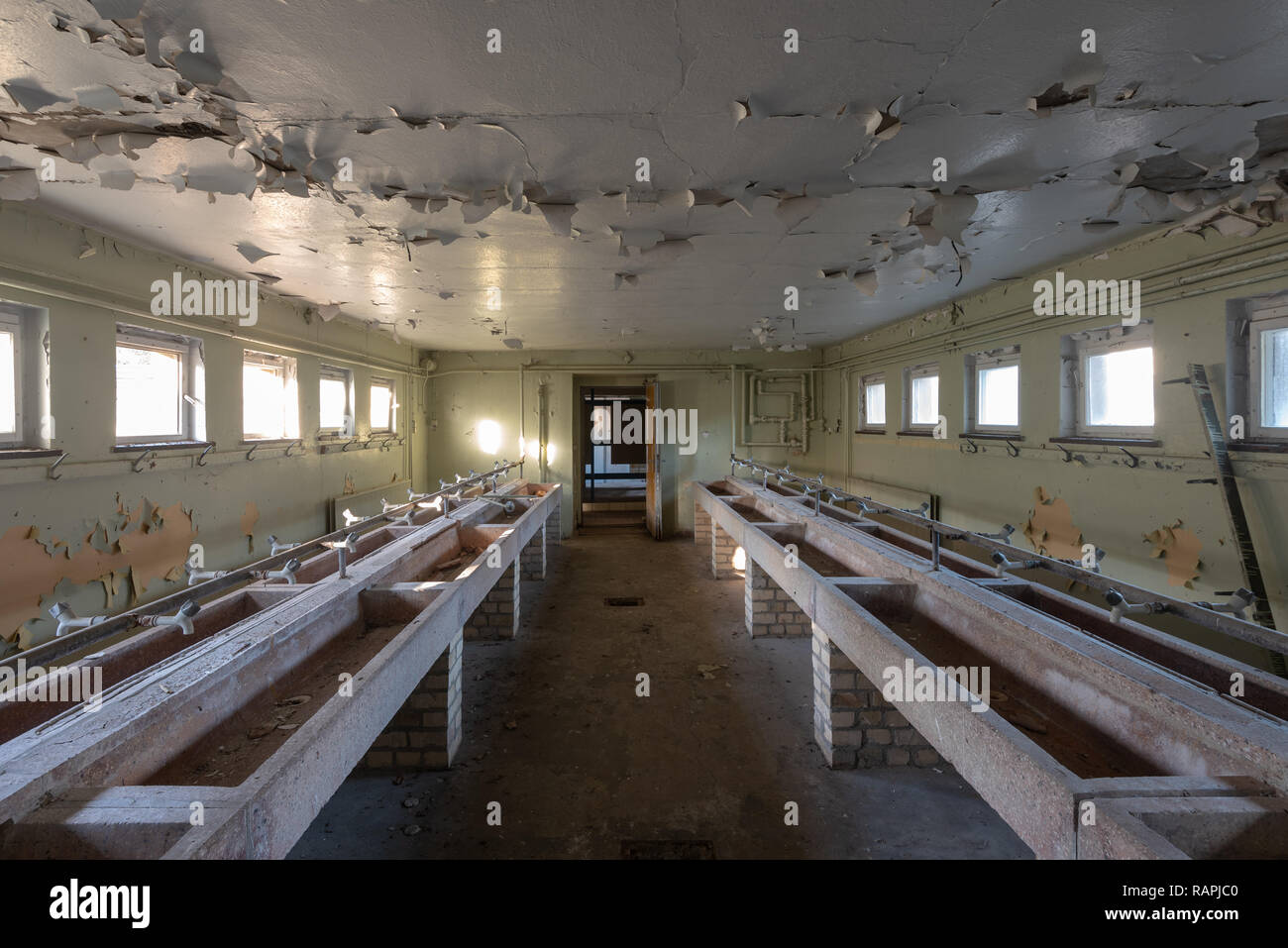 Prerow, Germany - December 30, 2018: View into the washroom of the former training centre of the Gesellschaft für Sport und Technik (GST) of the GDR i - Stock Image
