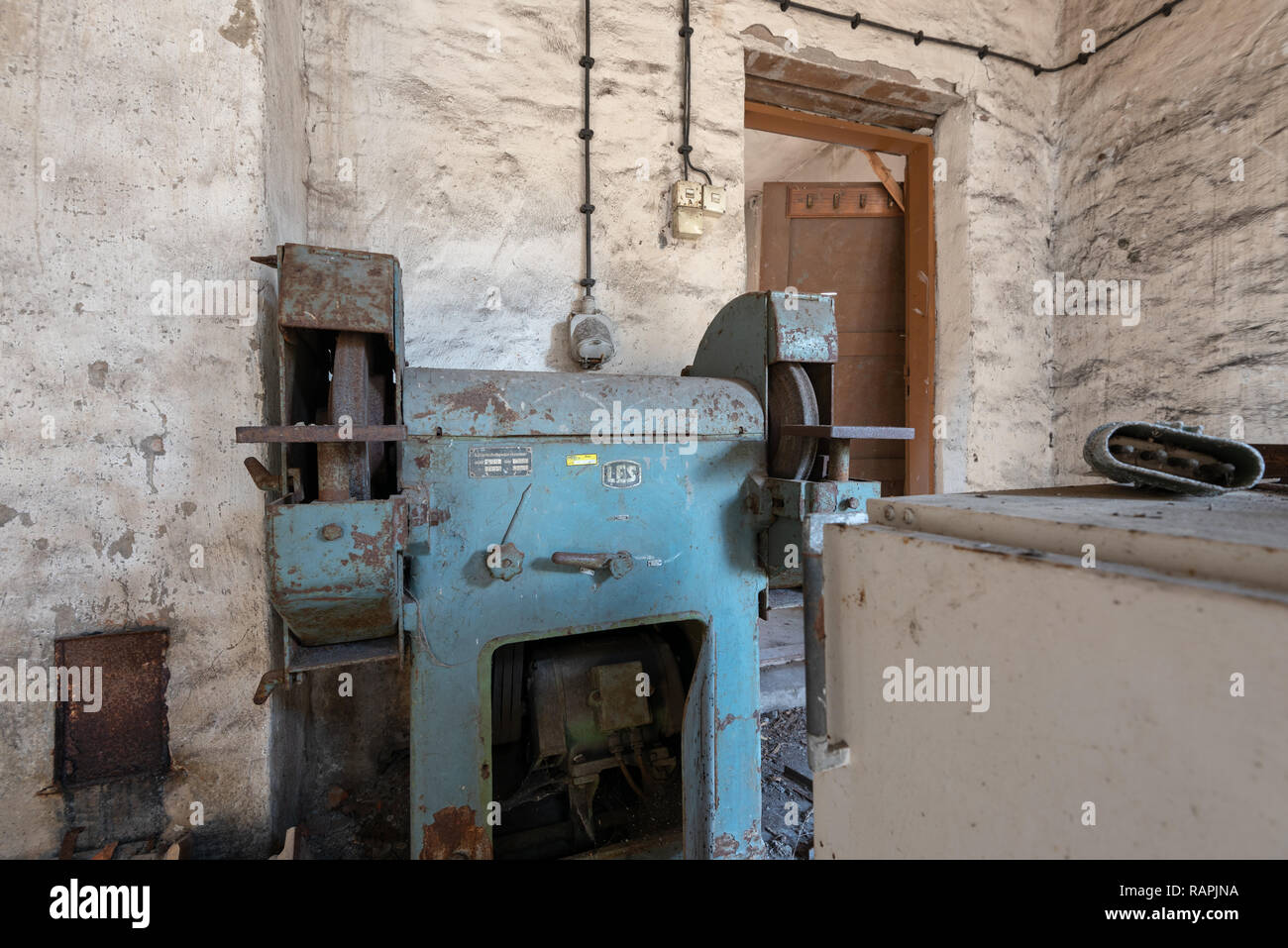 Prerow, Germany - December 30, 2018: View of an old grinding machine in the former training centre of the Gesellschaft für Sport und Technik (GST) of  - Stock Image