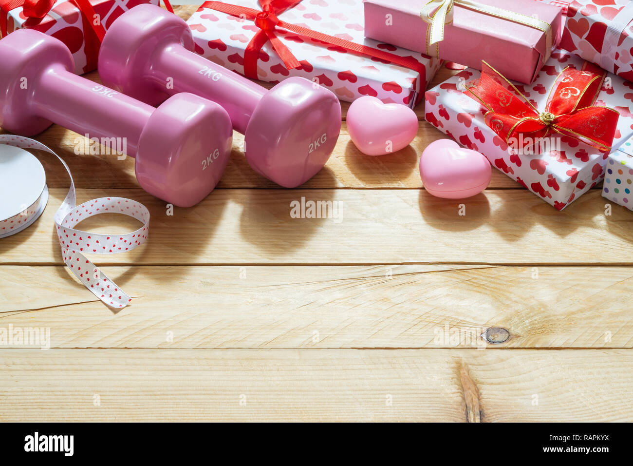 Pink Sport Dumbbells Heart Models And Gift Boxes On Wooden