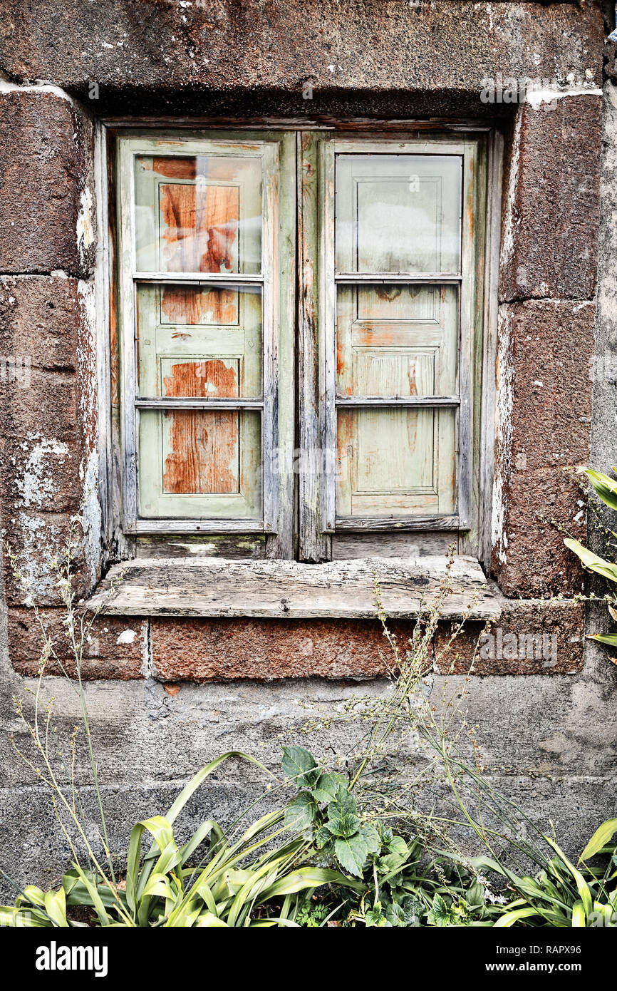 A Dilapidated Wooden Window In An Old Stone House On Madeira