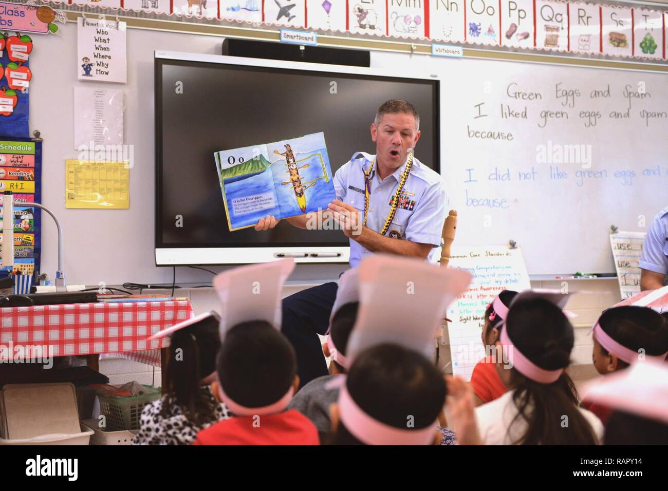 ... stationed at Coast Guard Recruiting Office Honolulu, reads to students  at Kalihi Waena Elementary school, March 3, 2017. Reading Across America  Day ...