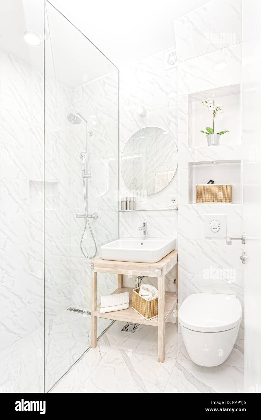Bright New Bathroom Interior With Glass Walk In Shower With Marble Tile Surround Stock Photo Alamy
