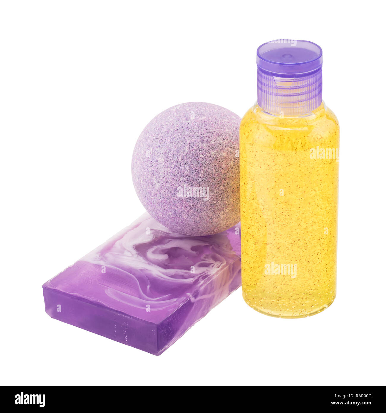 Composition of cosmetic products - bath bomb, handmade soap, bottle with scrub - Stock Image