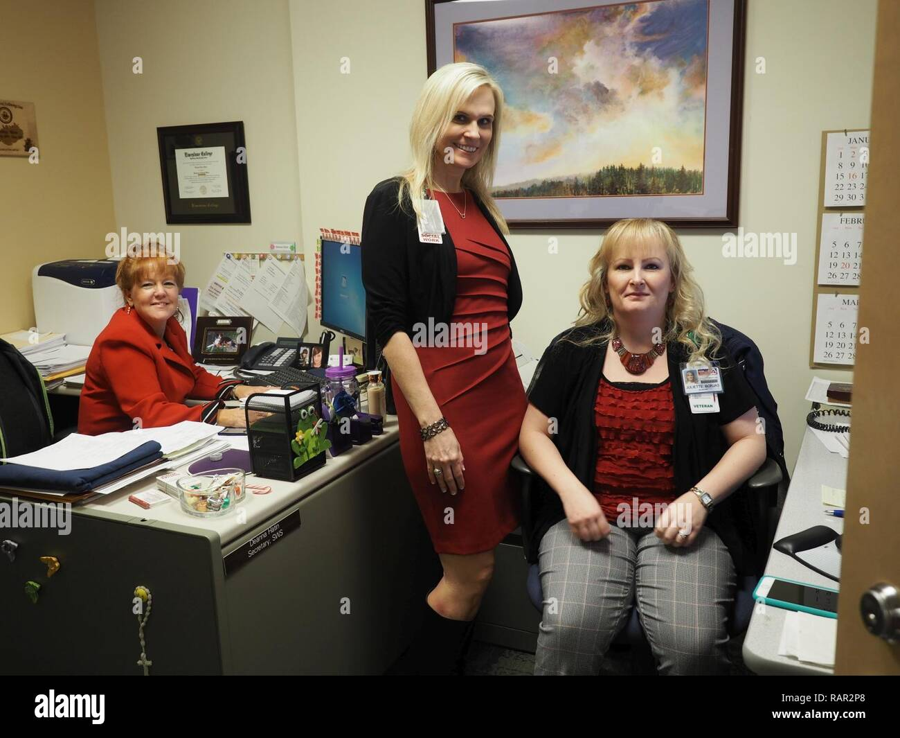 Social Work Services secretaries Deanna Hatin (left) and Juliette Borjas (right) are considered by chief of Social Work Services, Sherree Colvin (center) to be integral backbones of the Social Work department at Dorn VAMC. - Stock Image