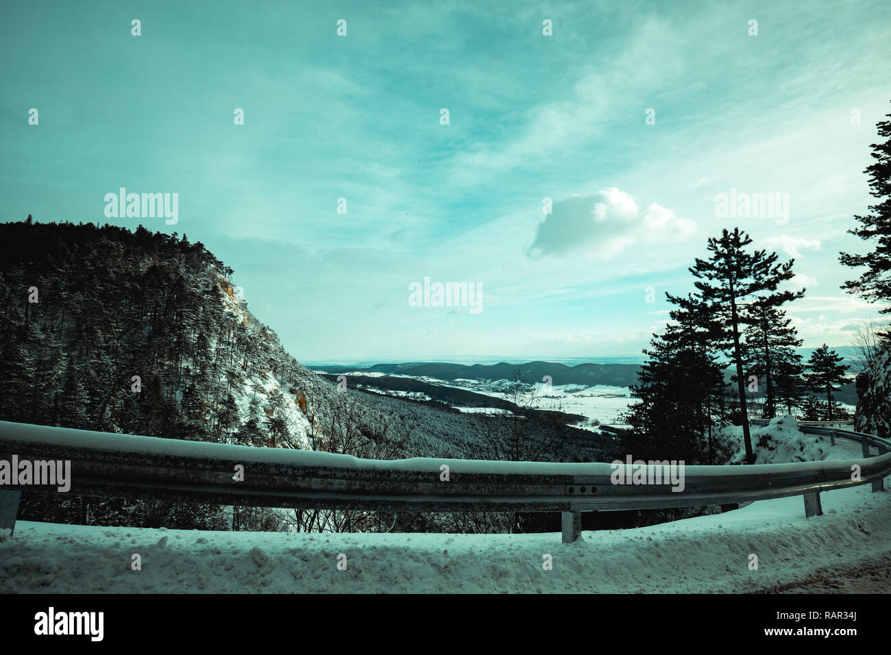 The road in the winter mountains in the background in lower austria hohe wand ( High Wall ) - Stock Image
