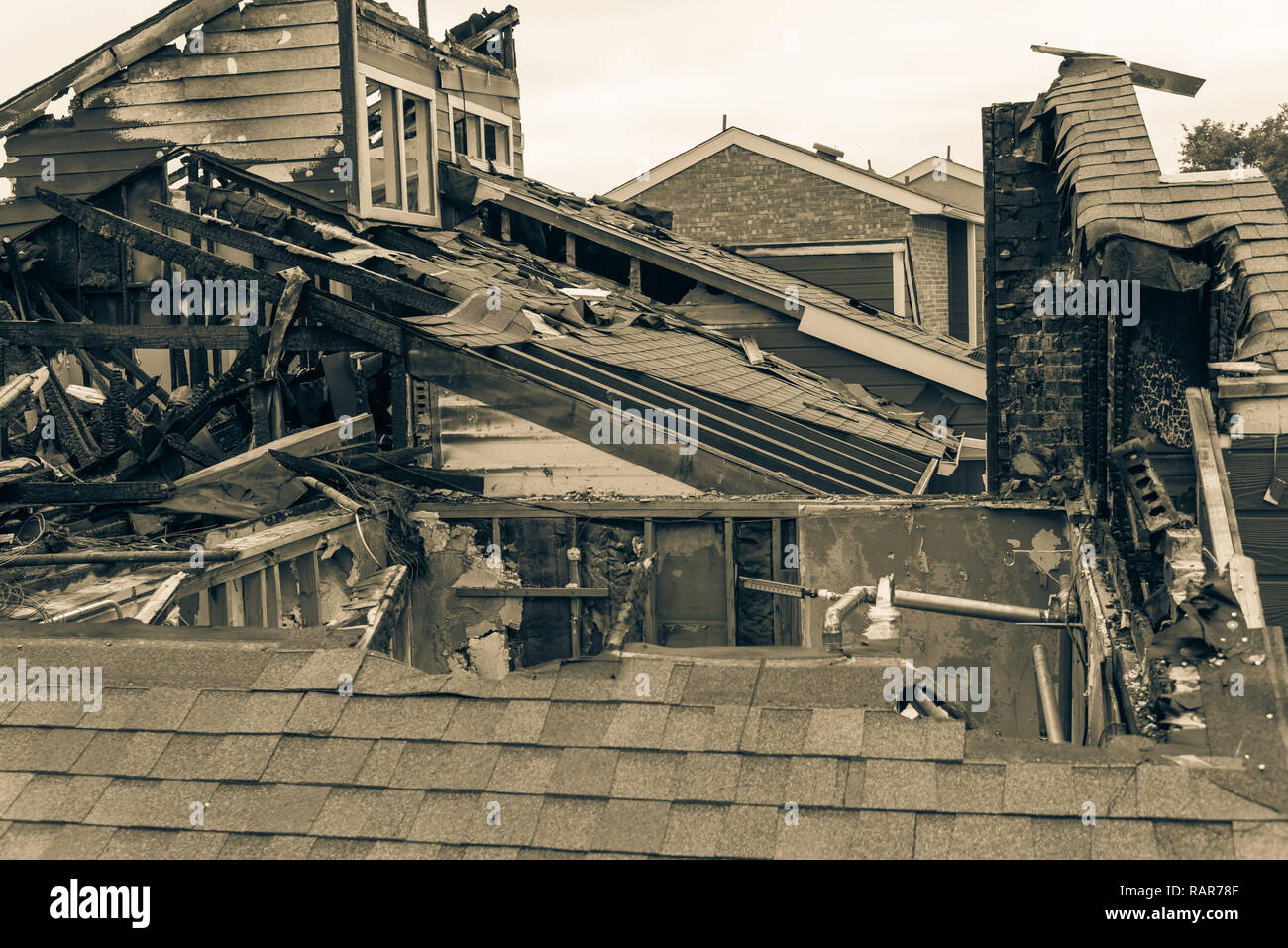 Filtered image damaged apartment building after burned by fire i - Stock Image