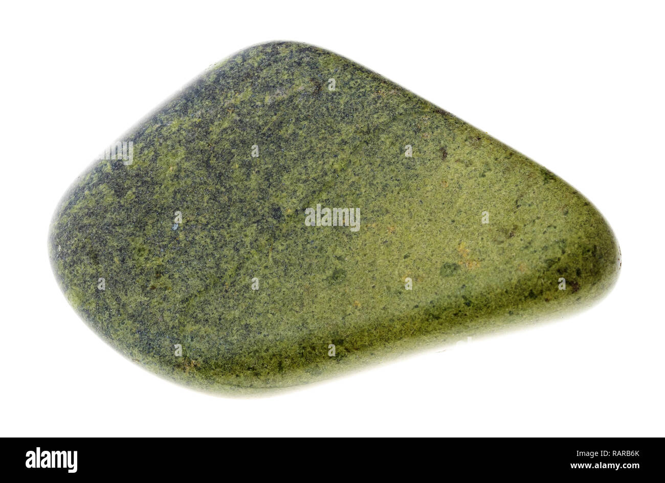 macro photography of natural mineral from geological collection - polished Epidote gemstone on white background - Stock Image