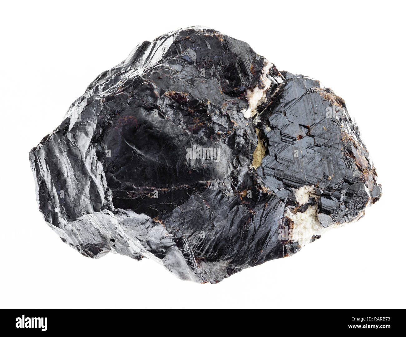 macro photography of natural mineral from geological collection - rough sphalerite (zinc blende) stone on white background - Stock Image